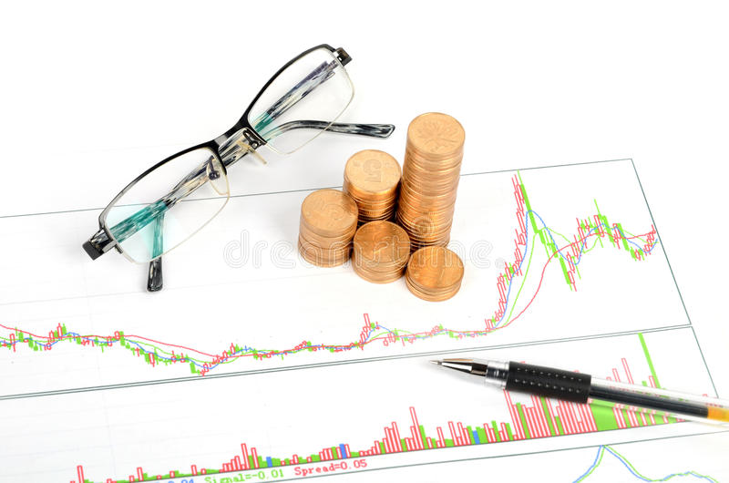 Stock trading. Glasses and pen with coin on stock trading royalty free stock photos