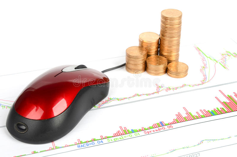 Stock trading. Computer mouse and coins with stock trading royalty free stock image
