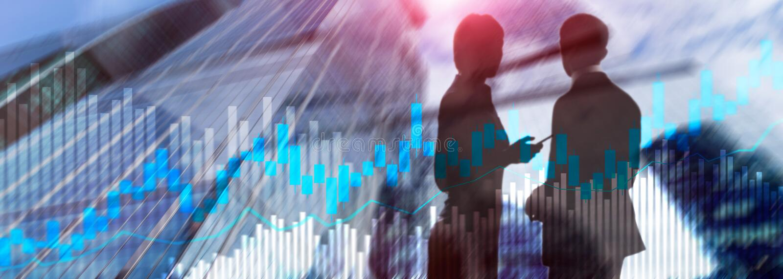 Stock trading candlestick chart and diagrams on blurred office center background.э. Stock trading candlestick chart and diagrams on blurred office center royalty free stock photos