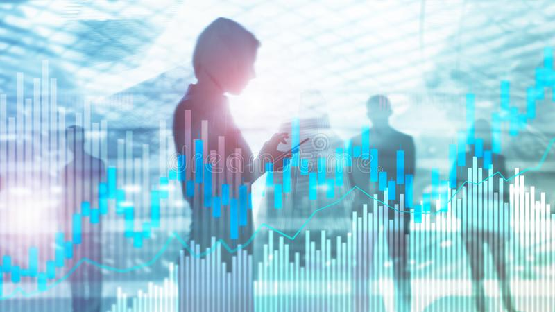 Stock trading candlestick chart and diagrams on blurred office center background.  royalty free stock images