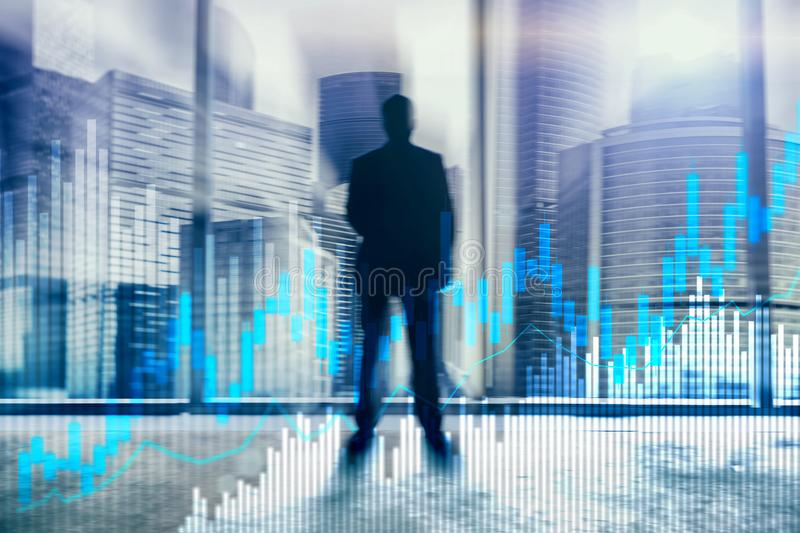 Stock trading candlestick chart and diagrams on blurred office center background.  royalty free stock photo