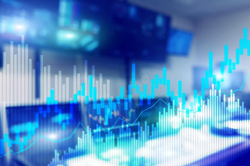 Stock trading candlestick chart and diagrams on blurred office center background.  stock photos
