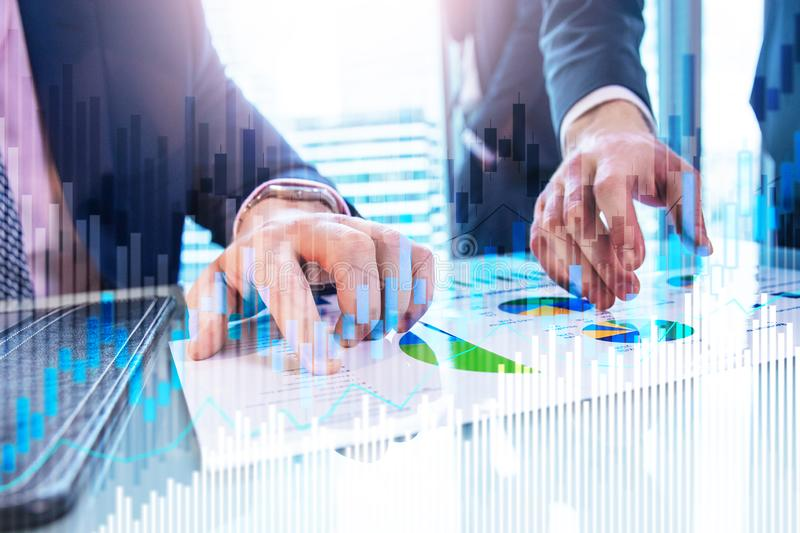 Stock trading candlestick chart and diagrams on blurred office center background.  stock photography
