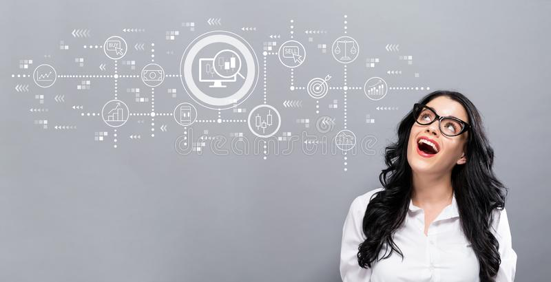 Stock trading concept with young businesswoman. In a thoughtful face stock image