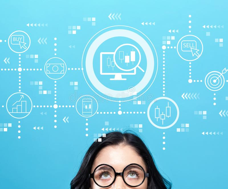 Stock trading concept with young woman. Wearing eye glasses stock image