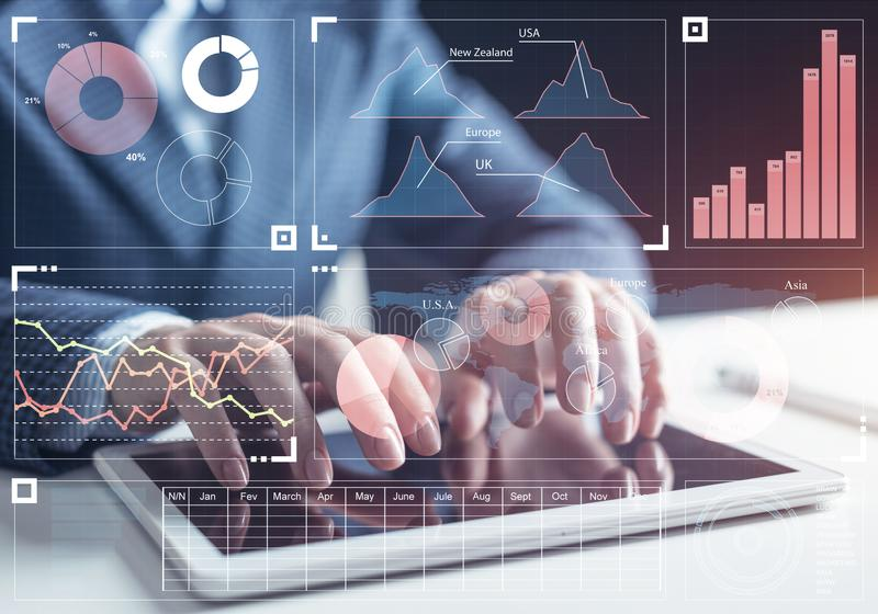 Stockbroker working with financial information. At tablet computer. Interactive stock market tracking graph, trading indicators and exchange indexes. Global royalty free stock photos