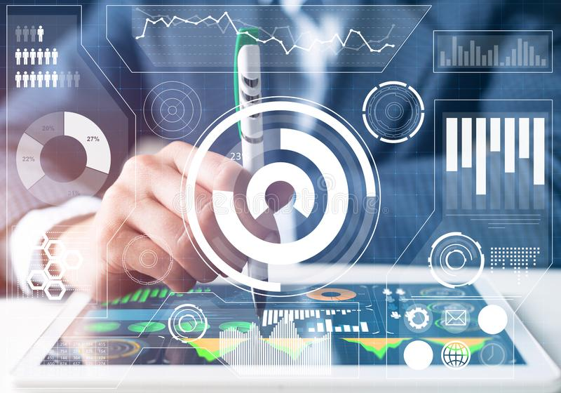 Stockbroker working with financial information. At tablet computer. Interactive stock market tracking graph, trading indicators and exchange indexes. Global stock photos