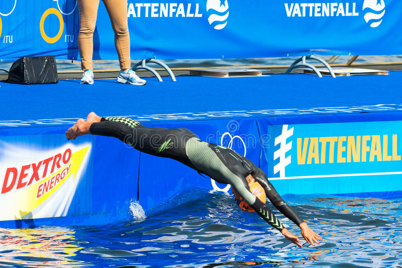 STOCKHOLM - AUG, 24: Charlotte Bonin diving into the water before the race, Womans ITU World Triathlon Series event Aug. 24, 2013 in Stockholm, Sweden royalty free stock images