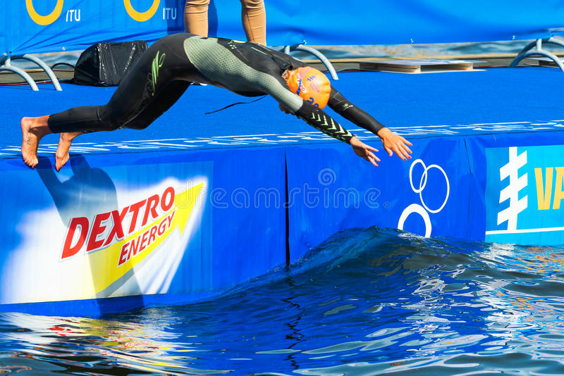 STOCKHOLM - AUG, 24: Charlotte Bonin diving into the water before the race, Womans ITU World Triathlon Series event Aug. 24, 2013 in Stockholm, Sweden stock photo