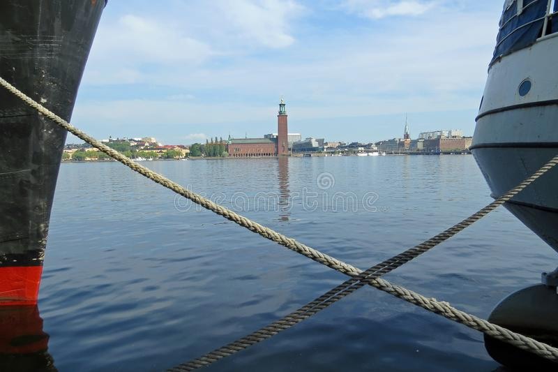 View between two boats on the famous city hall of Stockholm royalty free stock photography