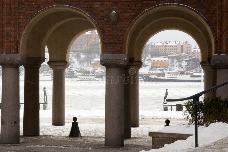 Stockholm Harbor from City Hall. View of Stockholm Harbor and Gamla Stan through archways at City Hall stock image