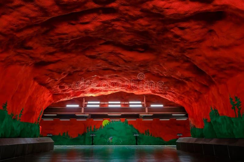 Stockholm metro or tunnelbana station Solna Centrum with fire li. Stockholm underground metro or tunnelbana station Solna Centrum with fire like wall designs stock photo