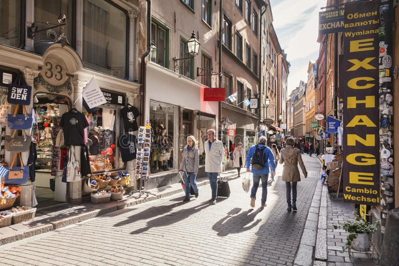 Stockholm Old Town Sweden. 16 September 2018: Stockholm, Sweden - Tourists wandering the streets of Gamla stan, Stockholm`s old town, on a sunny autumn day royalty free stock photos