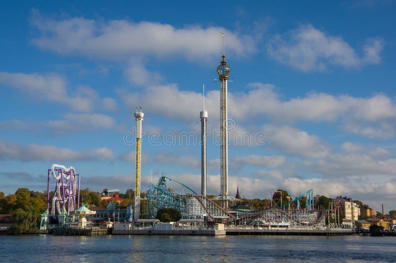 Stockholm Sverige - Oktober 15, 2016 Sikt av nöjesfältet Grona Lunds Tivoli från ön av Kastellholmen royaltyfri foto