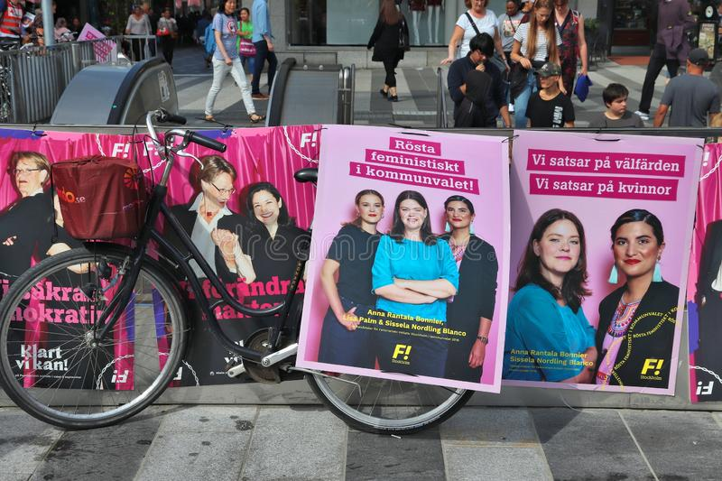 Feminist election posters. STOCKHOLM, SWEDEN - AUGUST 23, 2018: Feminist Initiative FI Feministiskt Initiativ political posters before Swedish general election royalty free stock photos