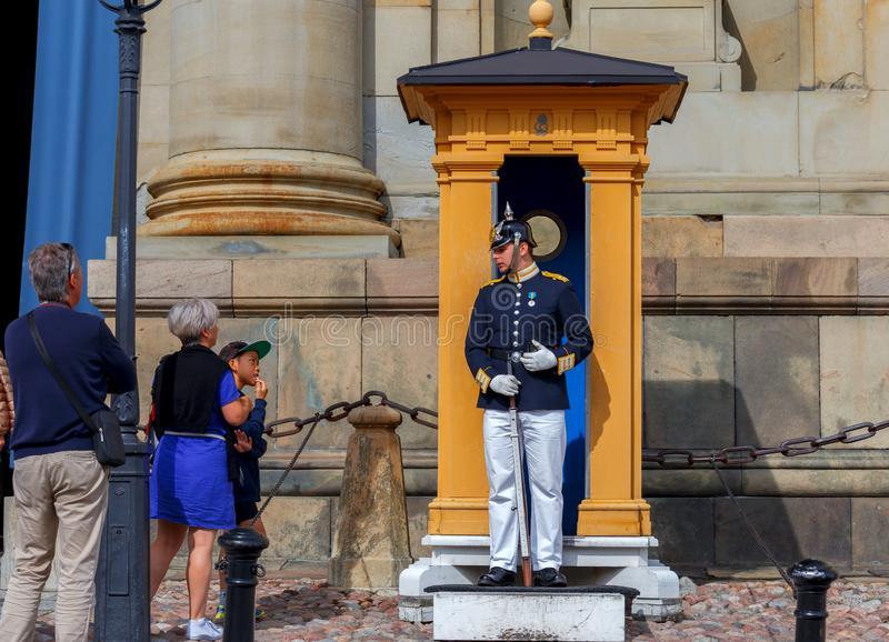 Stockholm. A guardsman with a rifle. Stockholm, Sweden - August 25, 2018: The guardsman on duty near the royal palace stock photos