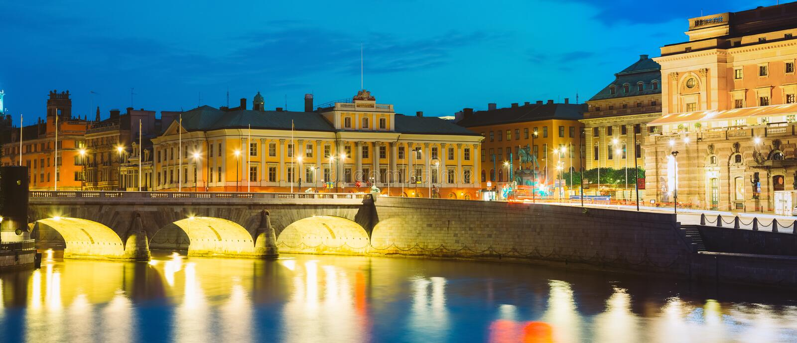 Stockholm Sweden. View Of Norrbro, Old Stone Arch Bridge Over Norrstrom Waterway With Lights Reflections In The Water. Stockholm, Sweden. The Evening Illuminated stock photography