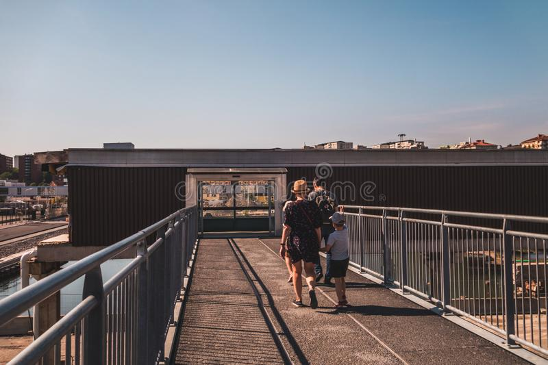 Stockholm Sweden Family walking to a gangway at the Vartan terminal on a sunny summer day royalty free stock photo