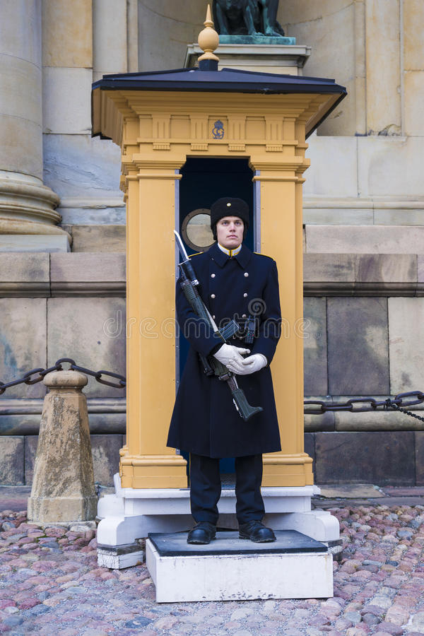 STOCKHOLM, SWEDEN - on JANUARY 4: The royal guardsman on a post stock images