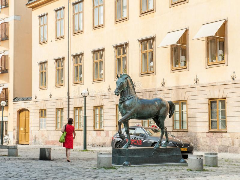 Blasieholmen square, Stockholm. Stockholm, Sweden - July 22, 2011: Blasieholmen square in the city center of Stockholm. A bronze horse inspired by the horses of royalty free stock photography