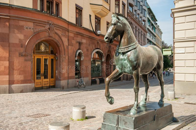 Blasieholmen square, Stockholm. Stockholm, Sweden - July 22, 2011: Blasieholmen square in the city center of Stockholm. A bronze horse inspired by the horses of royalty free stock image