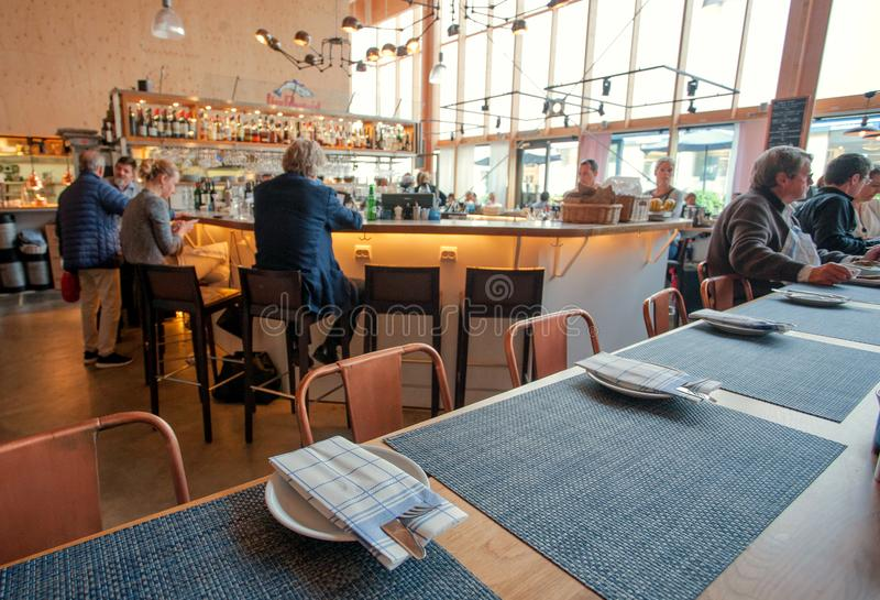 Many people having business lunch inside modern cafe or restaurant royalty free stock photos