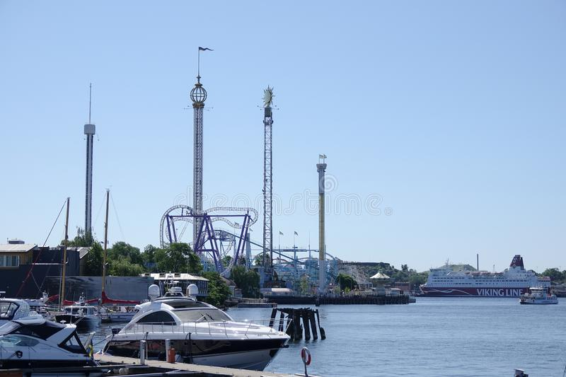Motorboats and amusement park Gröna / Grona Lund in the background. stock images