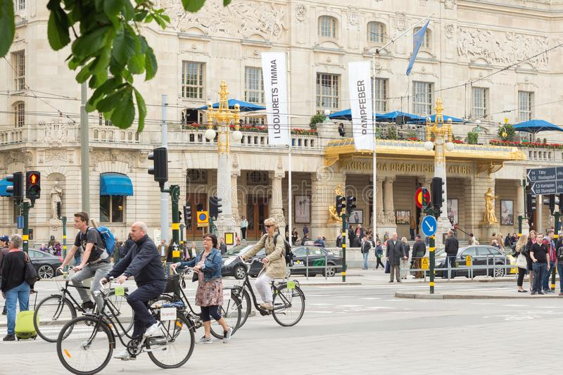 STOCKHOLM, SWEDEN - MAY 28, 2016: Street view with pedestrians and cyclists. Royal Dramatic Theatre in the background. royalty free stock photo