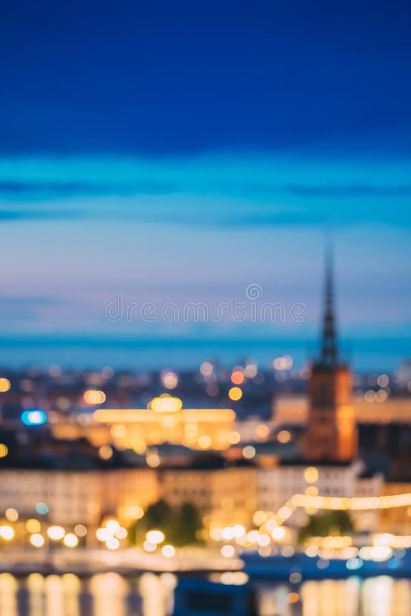 Stockholm, Sweden. Night Skyline Abstract Boke Bokeh Background. Design Backdrop. Riddarholm Church In Night Lighting. Stockholm, Sweden. Night Skyline Abstract royalty free stock images