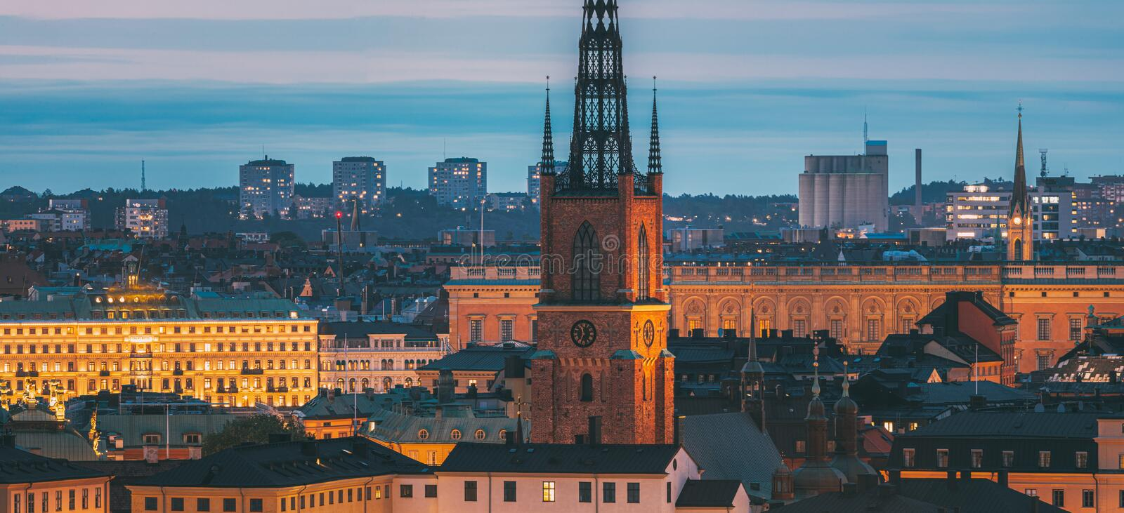 Stockholm, Sweden. Scenic View Of Stockholm Skyline At Summer Evening. Famous Popular Destination Scenic Place In Dusk. Lights. Riddarholm Church In Night royalty free stock images