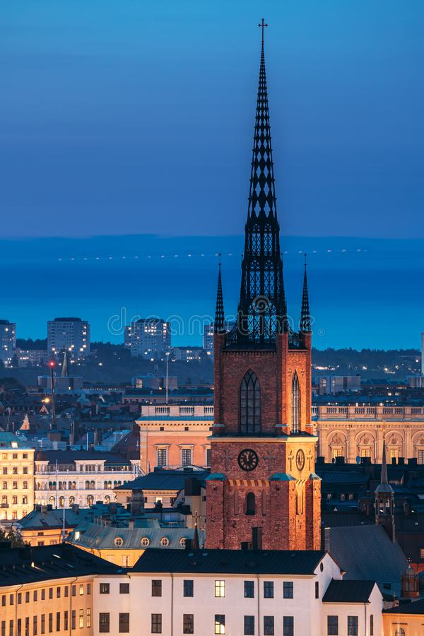 Stockholm, Sweden. Scenic View Of Stockholm Skyline At Summer Evening. Famous Popular Destination Scenic Place In Dusk. Lights. Riddarholm Church In Night royalty free stock image