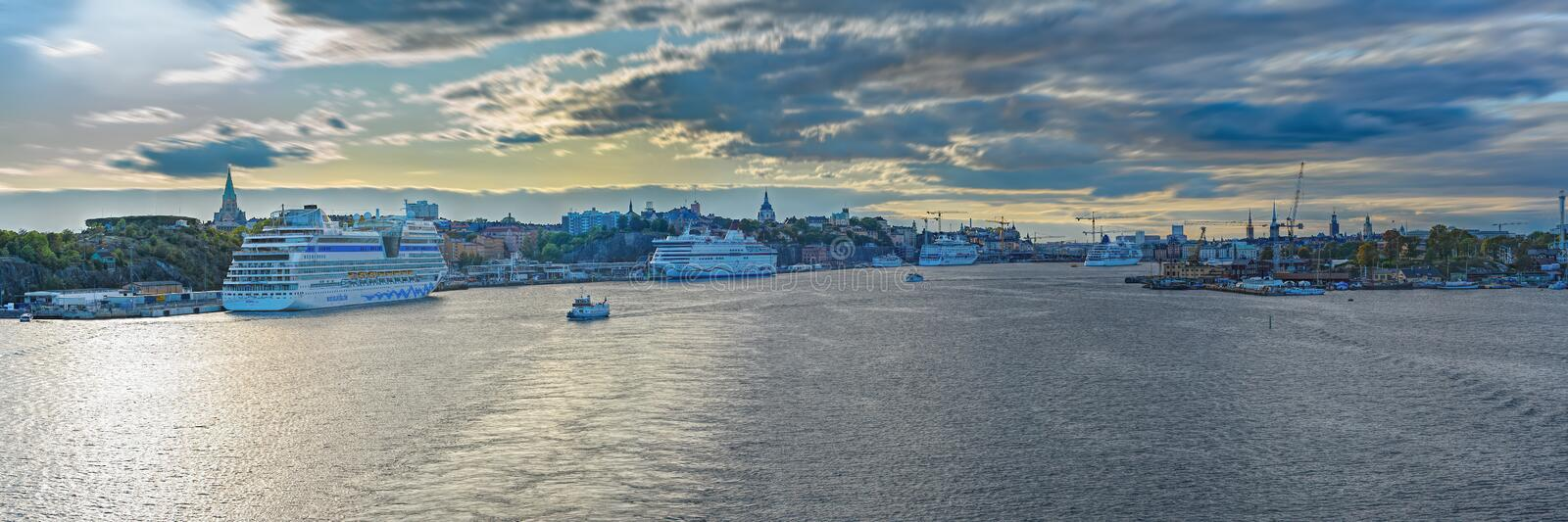 Scenic panoramic view of Stockholm`s coastline with a moored passenger ships at sunny autumn evening. Stockholm, Sweden. STOCKHOLM, SWEDEN - Sep 25, 2019: Scenic royalty free stock photography