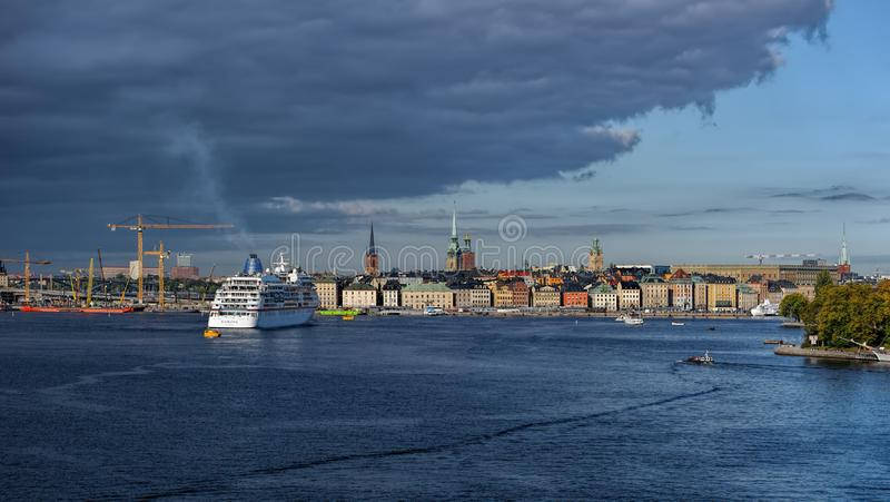 Scenic panoramic view of Stockholm`s Old Town Gamla Stan with a passenger ship berthed to mooring buoys on the foreground. STOCKHOLM, SWEDEN - Sep 25, 2019 royalty free stock photo