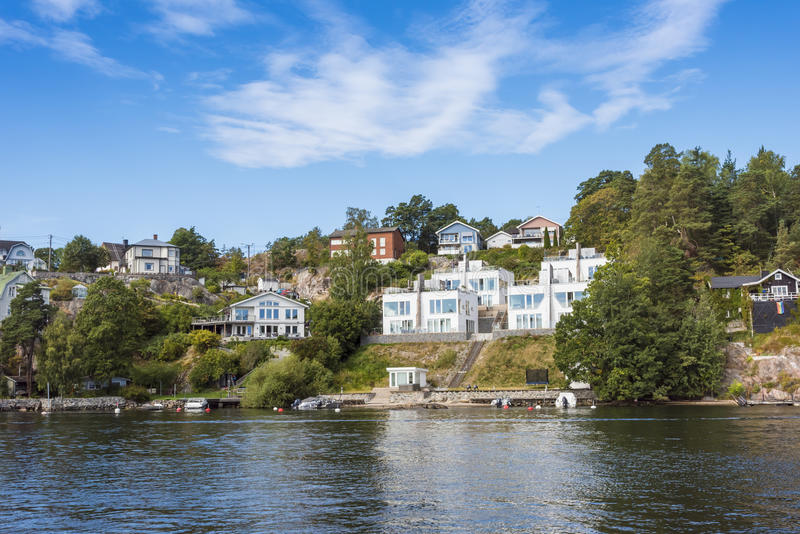Stockholm by the water: Skurusundet Nacka. Waterside houses in terraces in Nacka a suburban residentual area at Skurusundet, Stockholm, Sweden royalty free stock image
