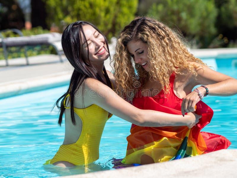 Lesbian teen in the pool