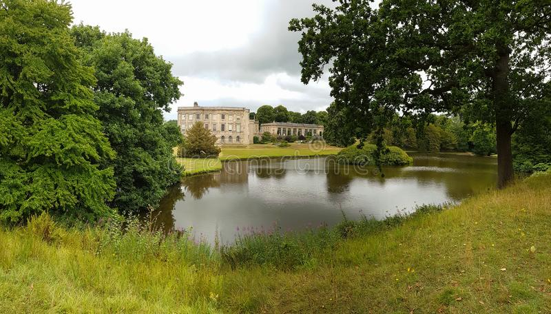 Lyme Hall, a historic English stately home inside Lyme Park in C. Stockport, United Kingdom - July 24, 2018: Lyme Hall, a historic English stately home inside royalty free stock photos