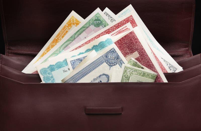 Stocks dans le cas de portefeuille images stock