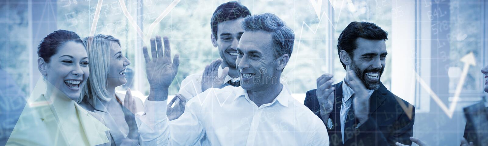 Composite image of stocks and shares. Stocks and shares against happy business executives giving high five royalty free stock images