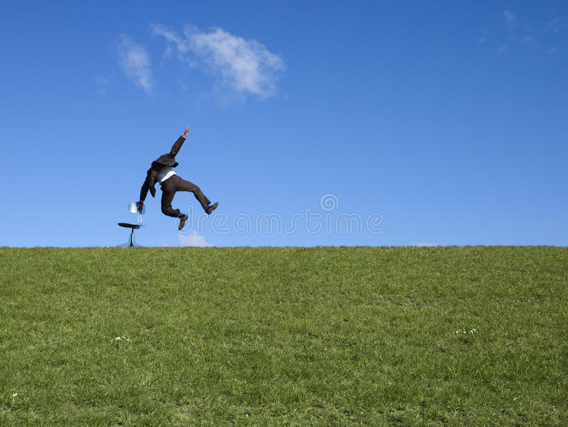 Stoel en springende Mens royalty-vrije stock afbeelding