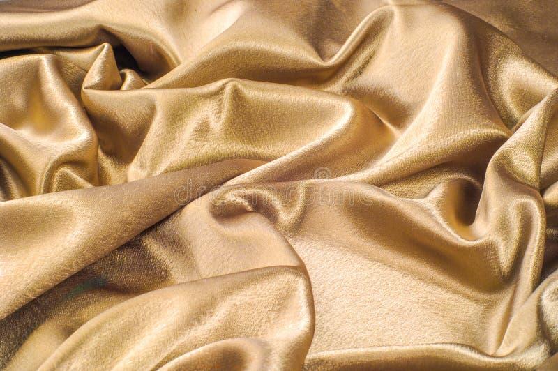 Stof van van de het metaaldraad van de zijdestof metaal de glansgoud dat wordt gemaakt Jus royalty-vrije stock foto