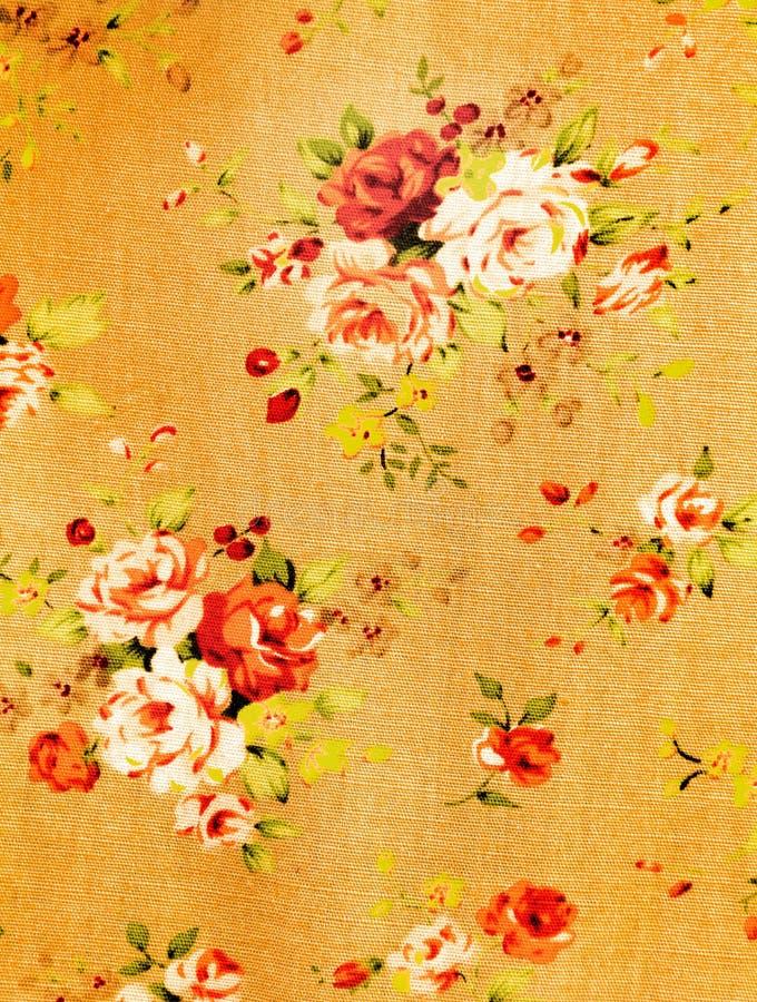 Stoffenpatroon met bloemenachtergrond royalty-vrije stock foto