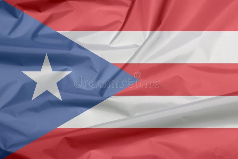 Stoffenvlag van Puerto Rico Vouw van de vlagachtergrond van Puerto Rico stock afbeeldingen