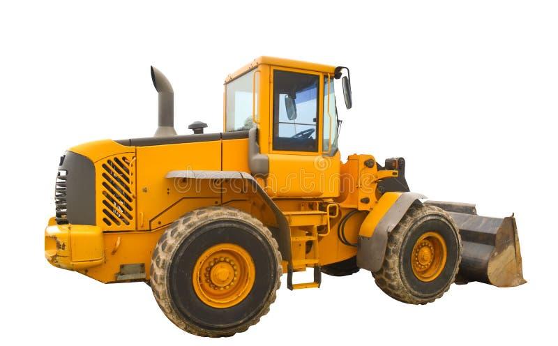 Stoffige grote bulldozerlader, die op zuivere witte achtergrond wordt geïsoleerd stock afbeeldingen
