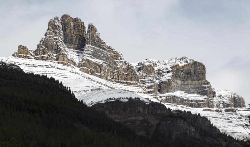 Stoic beauty. Stoic and snow-covered rock formations in Banff National Park, Alberta, Canada stock photo