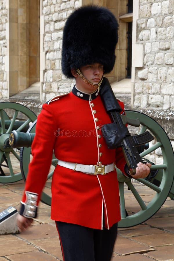 Stoic and vigilant Royal Guard at the Tower of London. London - July 30, 2017: A stoic and vigilant member of The Royal Guard at the Tower of London stock photography