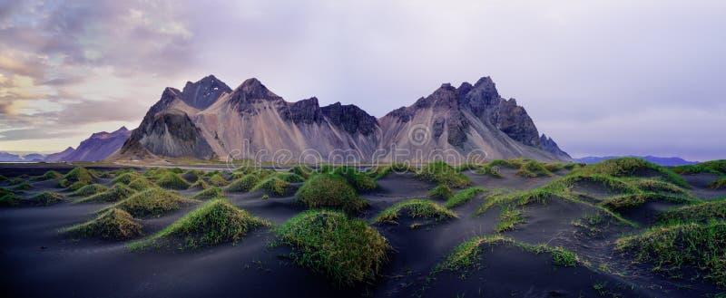 Stokksnes on southeastern Icelandic coast with Vestrahorn. Iceland. Sand dunes on the Stokksnes on southeastern Icelandic coast with Vestrahorn Batman Mountain royalty free stock images