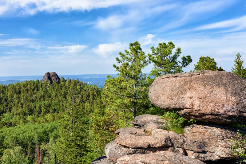 Stolby Nature Sanctuary `The Pillars`. View from fourth pillar to rock complex `Feathers`. Krasnoyarsk region. Russia stock photos