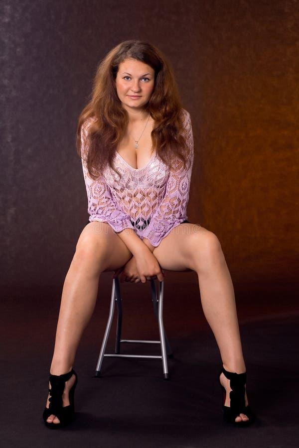 stolec siedząca kobieta zdjęcie stock