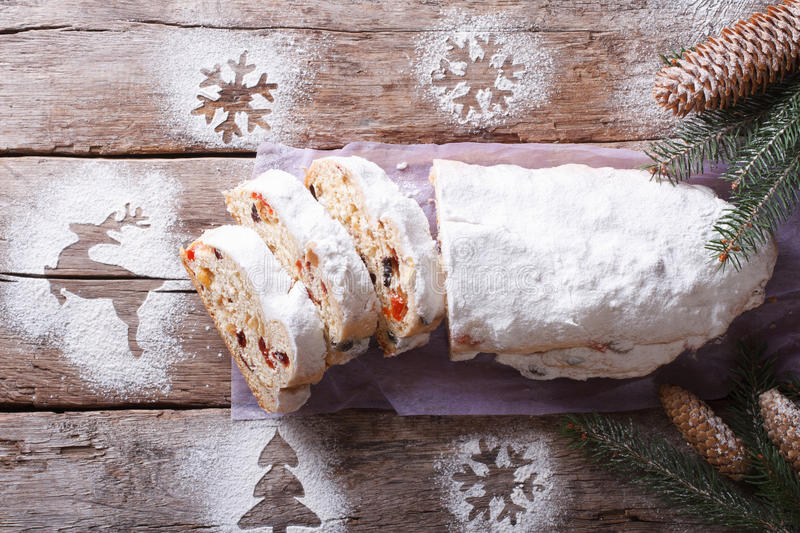 Stollen German Christmas cake cut on the table top view stock image