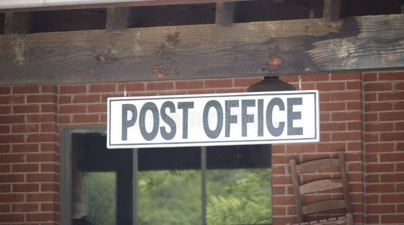 Stolpe - kontor av ett nationellt post- system arkivfoto